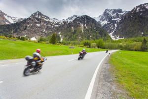 Motorcyclists ride the Maloja pass, Alps, Switzerland.